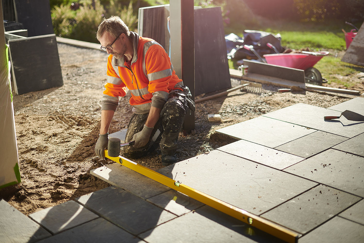landscape-construction-worker-laying-patio-pavers