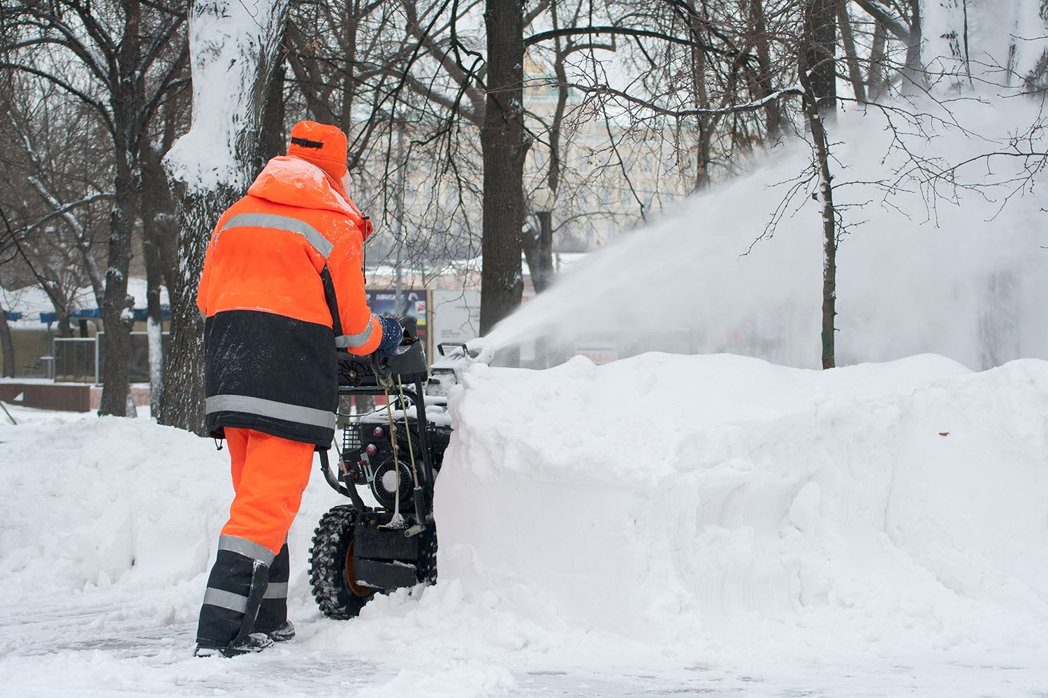 man-using-snowblower-for-snow-removal